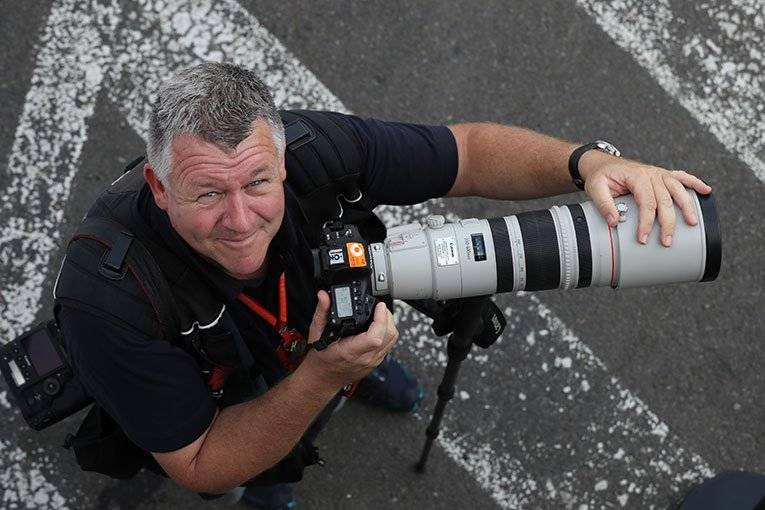 A CPS member looking pleased with his Canon photography equipment